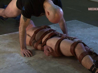 Naked and trussed on the floor
