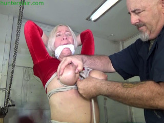 Tied down on a table with her big tits brutally bound and stretched in ropes