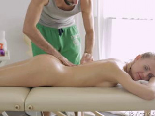 Julie lifts one leg to let masseur get a nicer look of her pussy