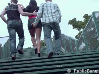 2 guys poke woman on a railway station