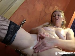 A mature ginger fuck slut and her big black dildo