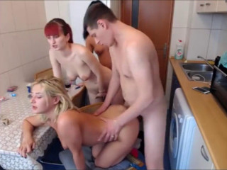 Group sex in the kitchen