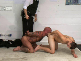 Teasing the sub the officers stroke his limp penis and hairy body, his torment
