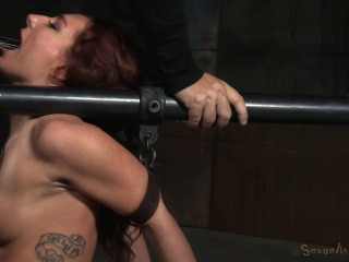 Red-haired Savannah Fox Shackled To A Sybian saddle