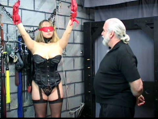 She is roped up with a tight crotchrope to make her cooch aching