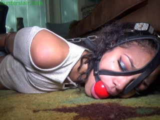 His new pretty neighbor struggles in a handcuffed, head harnessed, hogtie