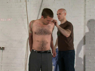 Arms tied behind his back and ball-gagged, made to strip himself