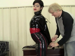 Tight bondage, domination and torment for sexy girl in latex