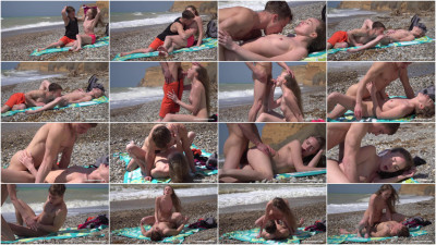 Alex Diaz — Young couple making out on the beach