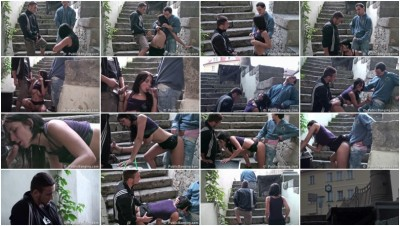 Two guys fuck a girl in the street on the stairs