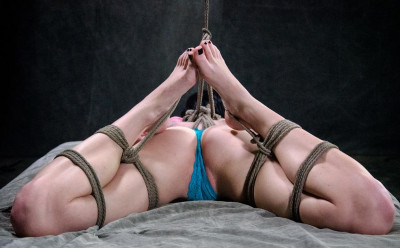 Young beauty in a hot submission
