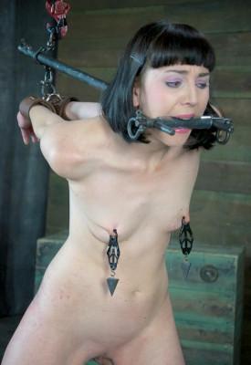 Beautiful girl in a hellish BDSM