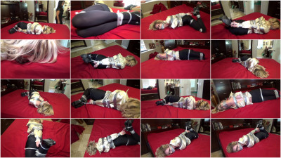 Hot Blonde Secretary Hogtied On A Bed