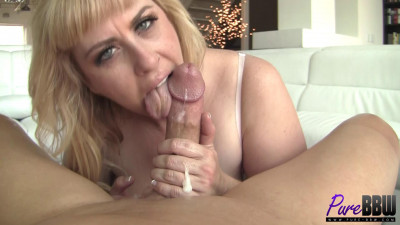 Busty blonde Lila Lovely jerks off a big dick