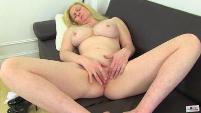 Big tit milf in white lingerie masturbates on sofa