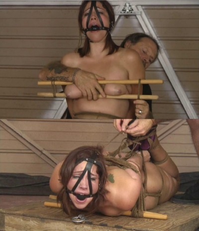 Extreme bondage and hogtie for naked girl with big tits