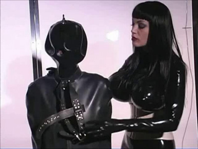 Two Beautiful Girls Are Dressed All In Latex