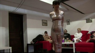 Sexy girl in a heavy plastic wrap - mummification