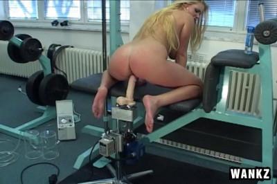 Titiana rides powerful mechanical dildo
