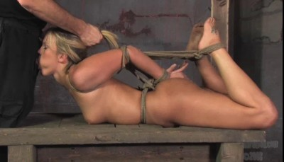 PD hoists her in the air by the ankles, puts her in a hogtie