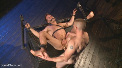 Description Tormented Without Mercy - Connor Patricks suffers tight metal bondage