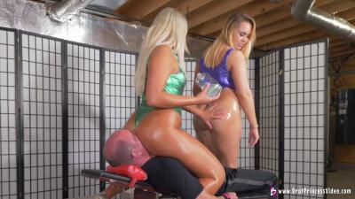 Ava And Natalya - Shiny Suits and Shiny Asses Face Sit