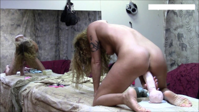 Fucking with a dildo in front of a mirror