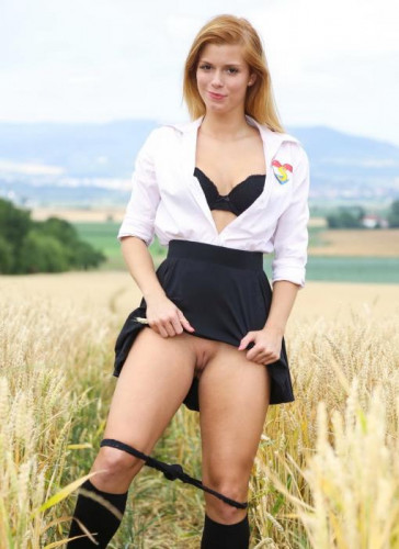 Schoolgirl Pleasuring Herself In A Wheat Field