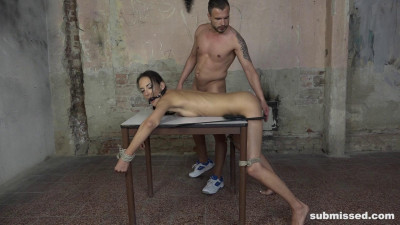 Tied to a table and hardcore fucked from behind