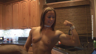 Sexy Female Bodybuilder in kitchen