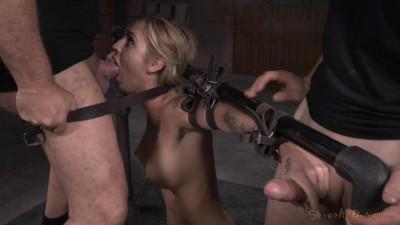 Tattooed hottie bent in half in belt bondage