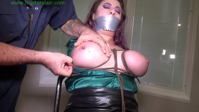 Buxom Cuban tied to a chair her massive tits bound with leather cords