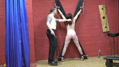 Crude crucifixion of A redhead