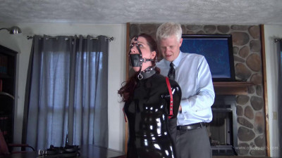Gmoras – Leather Hogtied in a Latex Catsuit