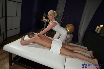 Description Oiled firm young blonde masseuse