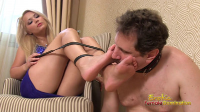 Slave on a leash sniffs his mistress's feet