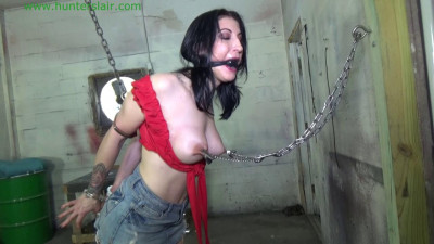 Busty MILF left handcuffed & nipple clamped to the wall