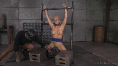 Holly Heart shackled to a sybian and throat trained by 2 cocks, cums hard!
