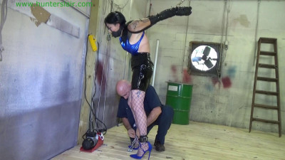 Tattoo'd wench bound in leather, zipties & chains