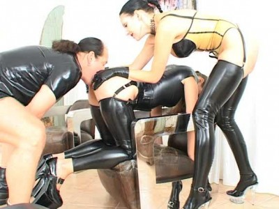 Three sniffing ass in latex