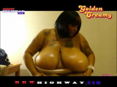 Golden Creamy rubs baby oil all over 46L ebony boobs