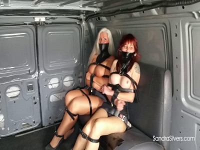 Buxom Milf Captives Cuffed, Strapped, Chained in Prison Van!