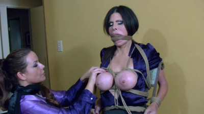 Tight bondage and torture for a horny Brunette