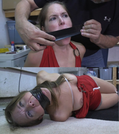 Tight bondage and hogtie for young model with sexy boobs.