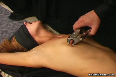 Pelvis thrusting at the vibrating wand Im holding to her shaved young pussy