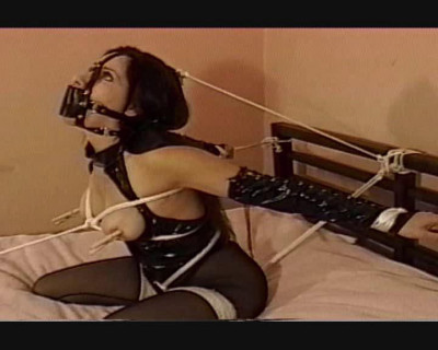 She Sat Down Again To Try And Loosen The Tope But She Still Remains Tied