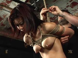 Cruelly bound with her ass presented for punishment