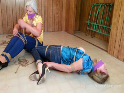 Description Tight Jeans and Tighter Ropes for Silk Bloused MILFs...
