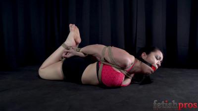 Description Escape Challenge for Brunette in Rope Hogtie