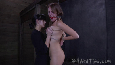 Alisha is helpless and naked, staring at her captor longingly for relief